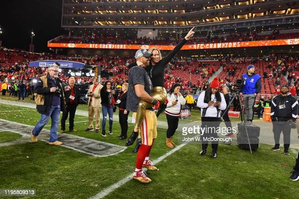 NFC Playoffs San Francisco 49ers Levine Toilolo victorious holding wife Stephanie on field after winning game vs Green Bay Packers at Levis Stadium...