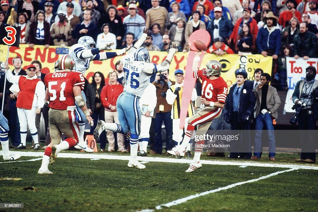 Football NFC playoffs San Francisco 49ers QB Joe Montana in action making under pressure pass vs Dallas Cowboys Larry Bethea San Francisco CA...