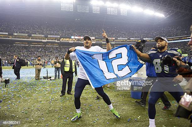 NFC Playoffs Seattle Seahawks Golden Tate and Jermaine Kearse victorious on field holding 12th man flag after winning game vs San Francisco 49ers at...