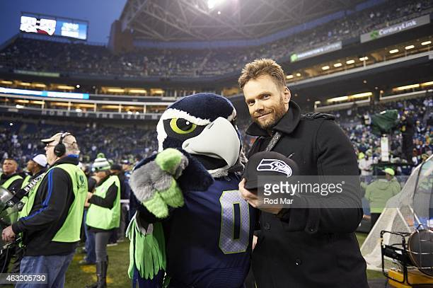 NFC Playoffs Seattle Seahawks mascot Blitz with actor comedian Joel McHale on field during game vs Carolina Panthers at CenturyLink Field Seattle WA...