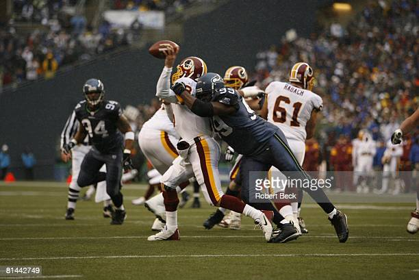 Football NFC Playoffs Seattle Seahawks Rocky Bernard in action making sack vs Washington Redskins QB Mark Brunell Seatte WA 1/14/2006
