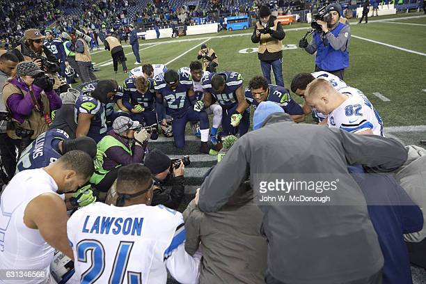 NFC Playoffs View of players kneeling in prayer on field before Seattle Seahawks vs Detroit Lions game at CenturyLink Field Seattle WA CREDIT John W...
