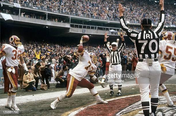 NFC Playoffs Washington Redskins Darryl Grant victorious spiking ball after scoring touchdown from interception vs Dallas Cowboys at RFK Stadium View...