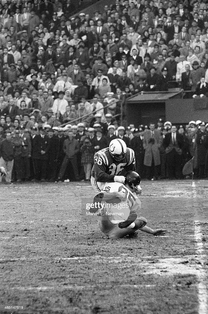 Baltimore Colts Bill Pellington (36) in action, making helmet tackle vs New York Giants Del Shofner (85) at Memorial Stadium. Marvin E. Newman F21 )