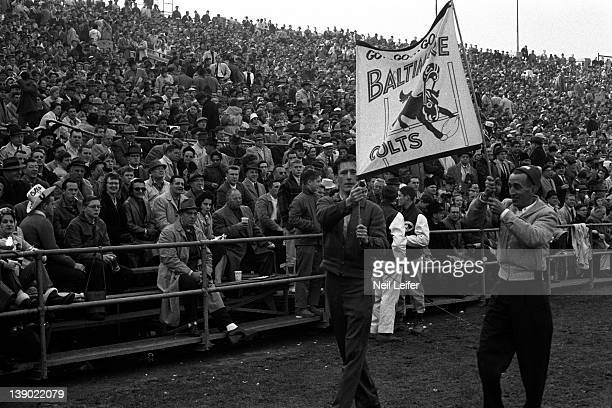 NFL Championship Baltimore Colts fans on sidelines holding sign reading GO GO GO BALTIMORE COLTS during game vs New York Giants at Memorial Stadium...