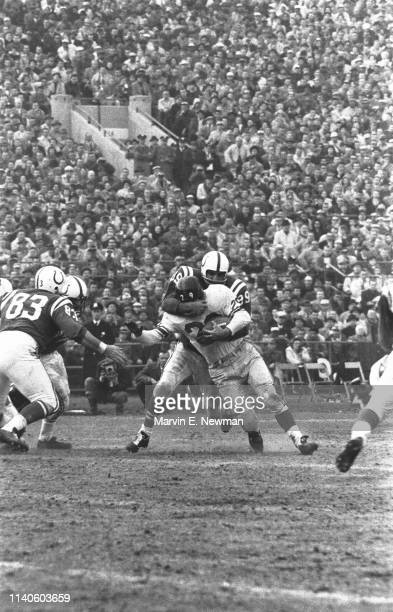 NFL Championship Baltimore Colts Gino Marchetti in action tackle on defense vs New York Giants Alex Webster at Memorial Stadium Baltimore MD CREDIT...