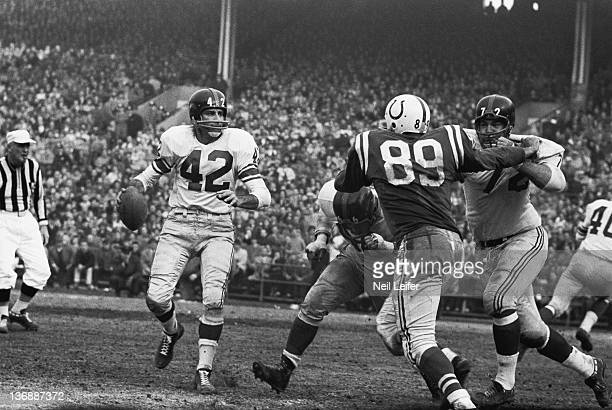 Football NFL Championship Baltimore Colts Gino Marchetti in action vs New York Giants Frank Youso Jack Stroud and QB Charlie Conerly at Memorial...