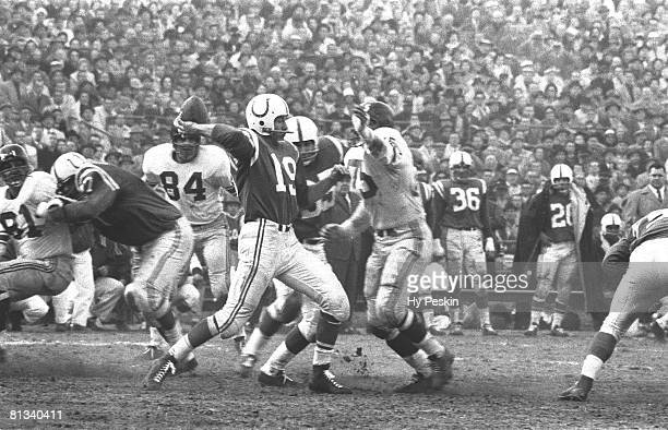 Football NFL championship Baltimore Colts QB Johnny Unitas in action making pass vs New York Giants Baltimore MD