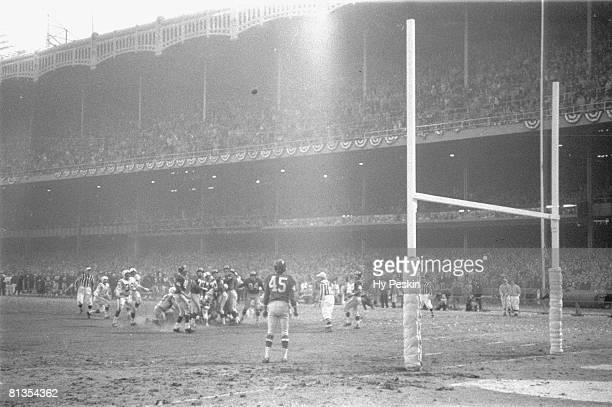Football NFL championship Baltimore Colts Steve Myrha in action making game tying field goal kick vs New York Giants View of Yankee Stadium Bronx NY