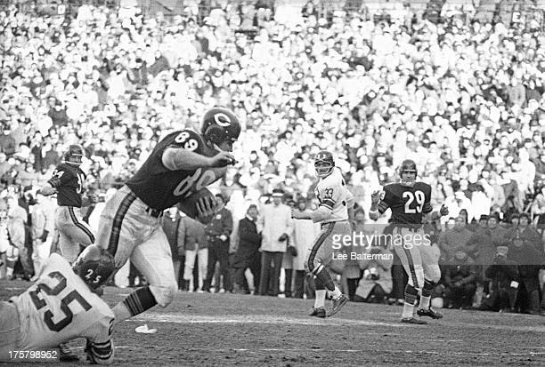 NFL Championship Chicago Bears Mike Ditka in action vs New York Giants Sam Huff at Wrigley Field Chicago IL CREDIT Lee Balterman