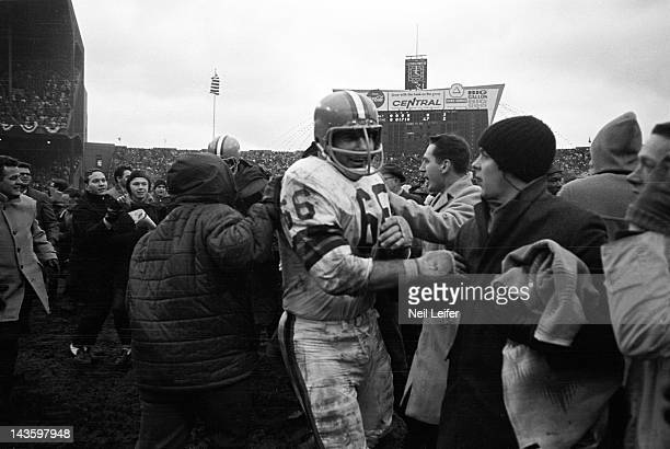NFL Championship Cleveland Browns Gene Hickerson victorious leaving field after winning game vs Baltimore Colts at Cleveland Municipal Stadium...