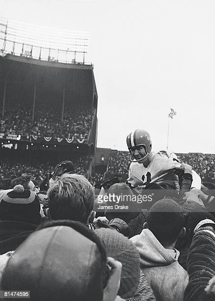 Football NFL championship Cleveland Browns QB Frank Ryan victorious getting carried off field by fans after winning game vs Baltimore Colts Cleveland...