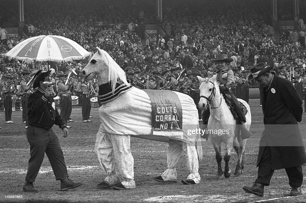 Fans on field in horse costume during Baltimore Colts vs New York Giants game at Memorial & Baltimore Colts vs New York Giants 1959 NFL Championship Pictures ...