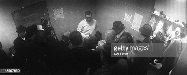 NFL Championship Green Bay Packers head coach Vince Lombardi in locker room with reporters after winning game vs New York Giants at City Stadium...