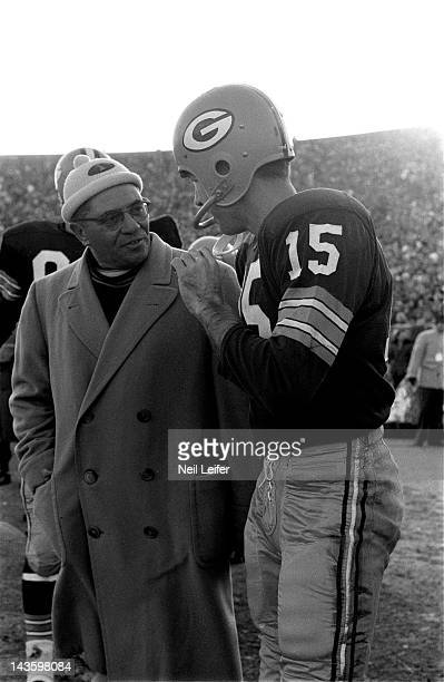 NFL Championship Green Bay Packers head coach Vince Lombardi and QB Bart Starr on sidelines during game vs New York Giants at City Stadium Green Bay...