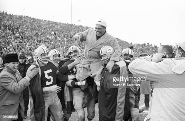 NFL Championship Green Bay Packers head coach Vince Lombardi victorious getting carried off field by team after winning game vs New York Giants Green...