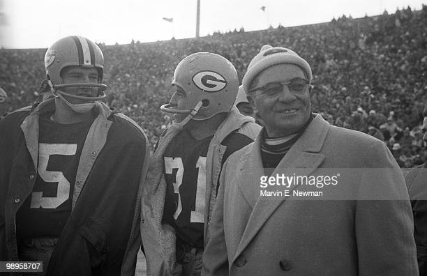 NFL Championship Green Bay Packers Paul Hornung and head coach Vince Lombardi during game vs New York Giants Green Bay WI CREDIT Marvin E Newman