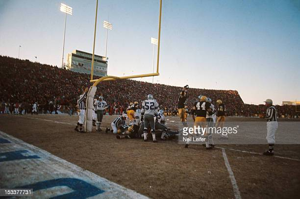 NFL Championship Green Bay Packers QB Bart Starr in action scoring game winning touchdown vs Dallas Cowboys during 4th quarter of 'Ice Bowl' game at...
