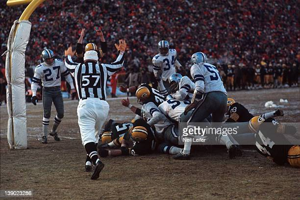 NFL Championship Green Bay Packers QB Bart Starr in endzone after scoring touchdown vs Dallas Cowboys during Ice Bowl game at Lambeau Field The...