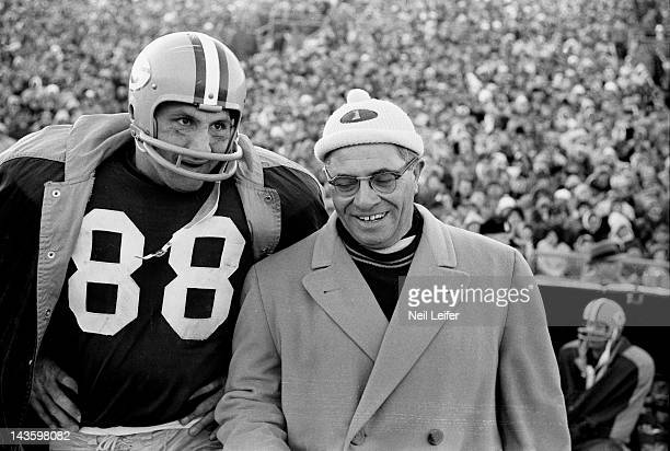 NFL Championship Green Bay Packers Ron Kramer and head coach Vince Lombardi on sidelines during game vs New York Giants at City Stadium Green Bay WI...