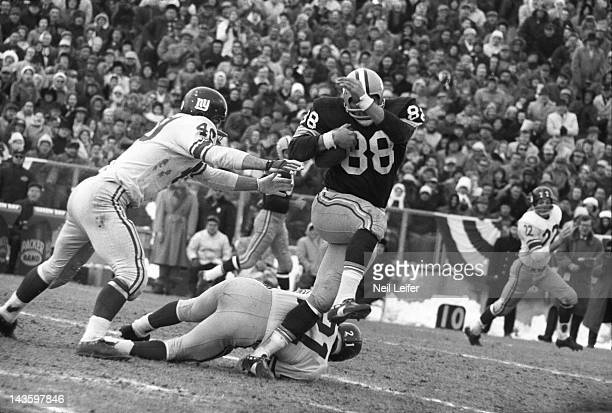 NFL Championship Green Bay Packers Ron Kramer in action vs New York Giants Joe Morrison at City Stadium Green Bay WI CREDIT Neil Leifer