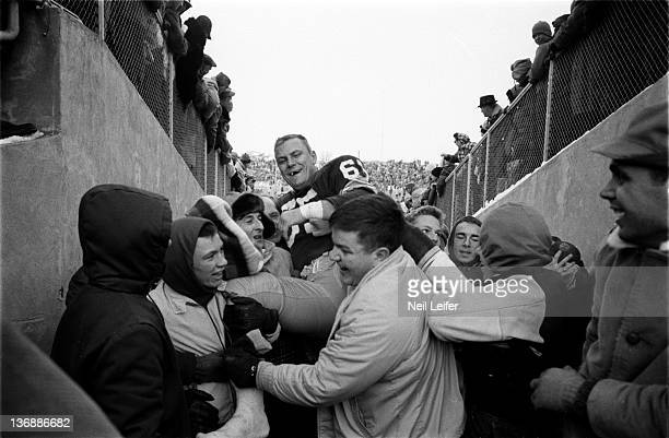 Football NFL Championship Green Bay Packers Tom Bettis victorious getting carried into tunnel by fans after winning game vs New York Giants at City...