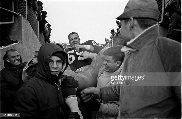 NFL Championship Green Bay Packers Tom Bettis victorious getting carried into tunnel by fans after winning game vs New York Giants at City Stadium...