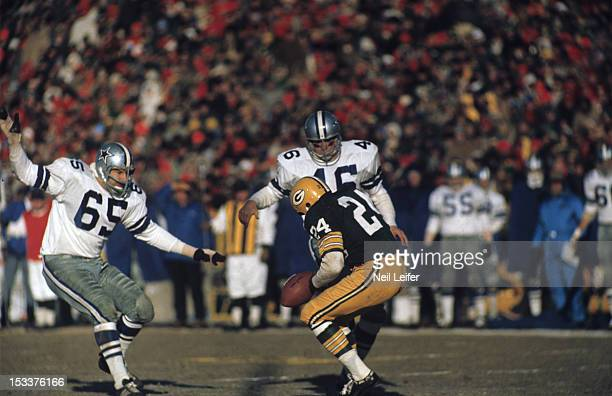 NFL Championship Green Bay Packers Willie Wood in action attempting catch vs Dallas Cowboys during 'Ice Bowl' game at Lambeau Field The official...