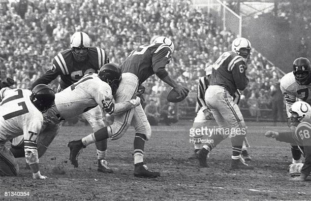 Football NFL championship New York Giants Andy Robustelli in action making sack vs Baltimore Colts QB Johnny Unitas Baltimore MD