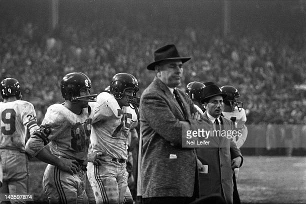 NFL Championship New York Giants Cliff Livingston Jim Katcavage and head coach Jim Lee Howell on sidelines during game vs Baltimore Colts at Memorial...