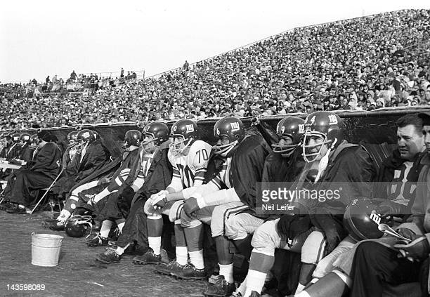 NFL Championship New York Giants Dick Modzelewski Sam Huff Rosey Grier Erich Barnes and teammates seated on sidelines during game vs Green Bay...