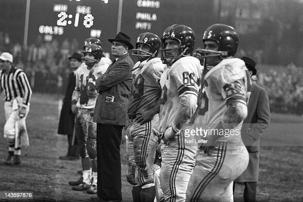 NFL Championship New York Giants Frank Gifford head coach Jim Lee Howell Cliff Livingston Jack Stroud and Ray Wietecha on sidelines during game vs...