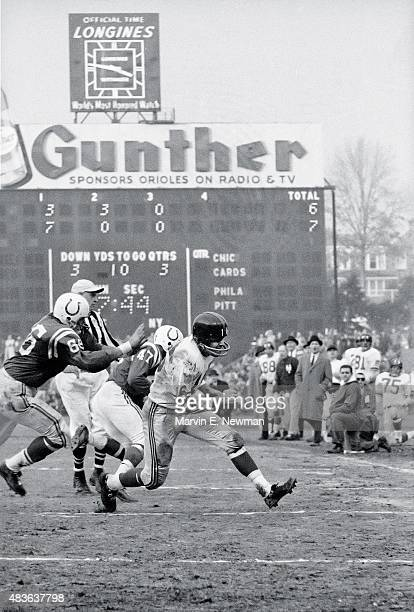 NFL Championship New York Giants Frank Gifford in action rushing vs Baltimore Colts at Memorial Stadium Baltimore MD CREDIT Marvin E Newman