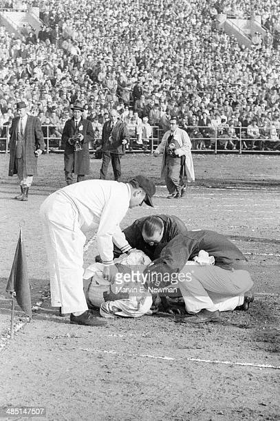 NFL Championship New York Giants Kyle Rote on ground after sustaining injury during game vs Baltimore Colts at Memorial Stadium Baltimore MD CREDIT...