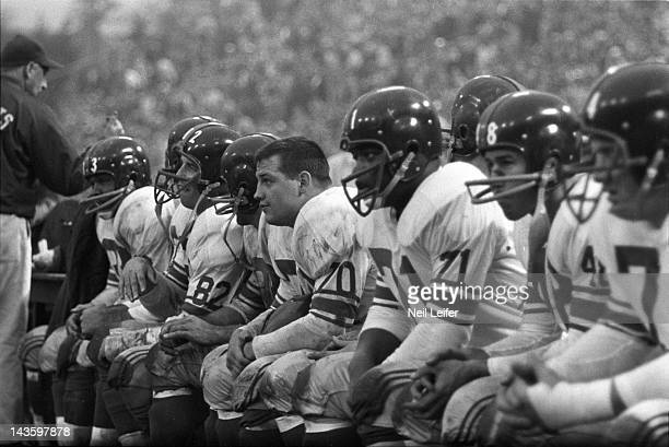 NFL Championship New York Giants Mel Triplett Tom Scott Sam Huff Ellison Kelly Bill Stits and Art Hauser on sidelines bench with teammates during...