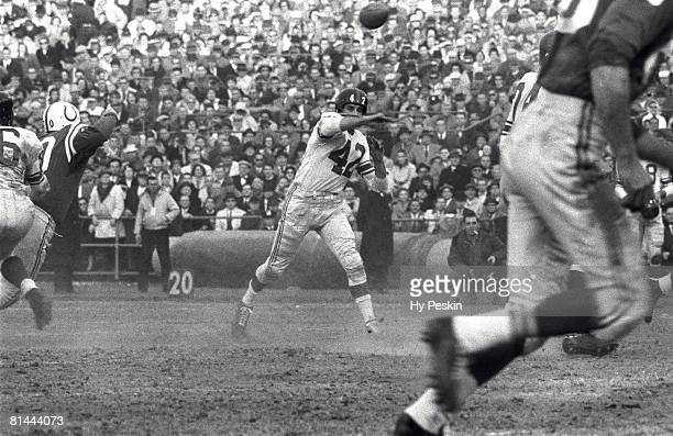 Football NFL championship New York Giants QB Chuck Conerly in action making pass vs Baltimore Colts Baltimore MD