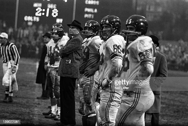 NFL Championship New York Giants Ray Wietecha Jack Stroud and Cliff Livingston on sidelines during game vs Baltimore Colts at Memorial Stadium...