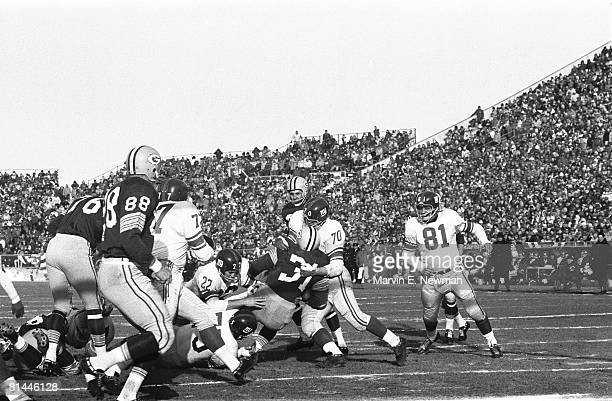Football NFL championship New York Giants Sam Huff and Dick Lynch in action making tackle vs Green Bay Packers Jim Taylor Green Bay WI