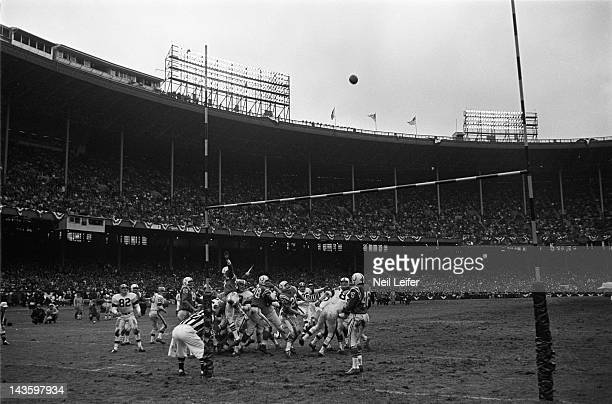 NFL Championship Overall view of ball in air during Cleveland Browns field goal attempt vs Baltimore Colts at Cleveland Municipal Stadium Cleveland...