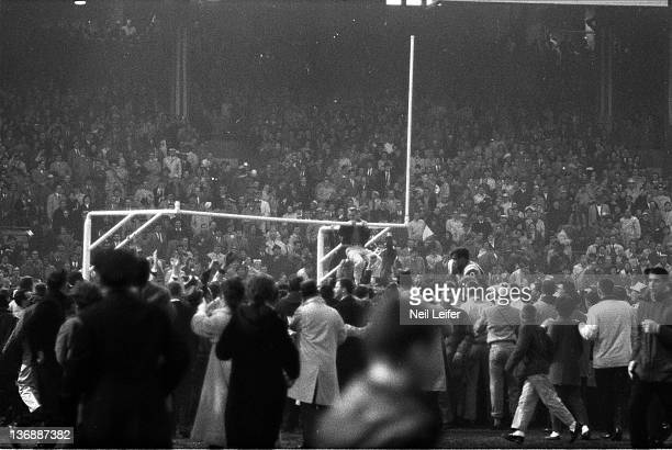 Football NFL Championship Overall view of fans victorious on field after New York vs Baltimore Colts game at Memorial Stadium Baltimore MD CREDIT...