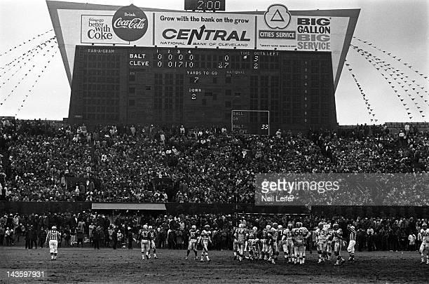 NFL Championship Overall view of players on field during Cleveland Browns vs Baltimore Colts game at Cleveland Municipal Stadium View of scoreboard...
