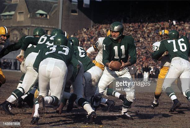 NFL Championship Philadelphia Eagles QB Norm Van Brocklin in action handoff to Billy Ray Barnes vs Green Bay Packers at Franklin Field Philadelphia...