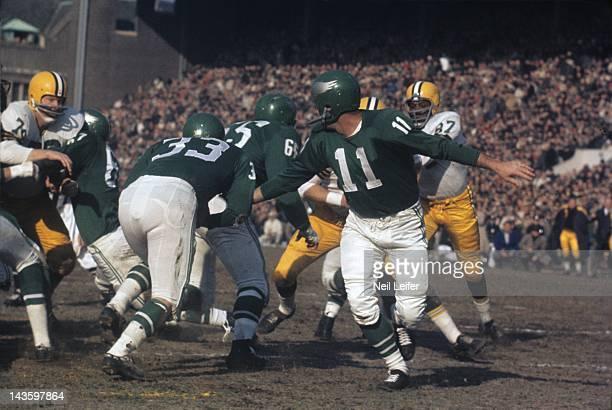 NFL Championship Philadelphia Eagles QB Norm Van Brocklin in action handoff to Billy Ray Barnes vs Green Bay Packers at Franklin Field Philadelphia...