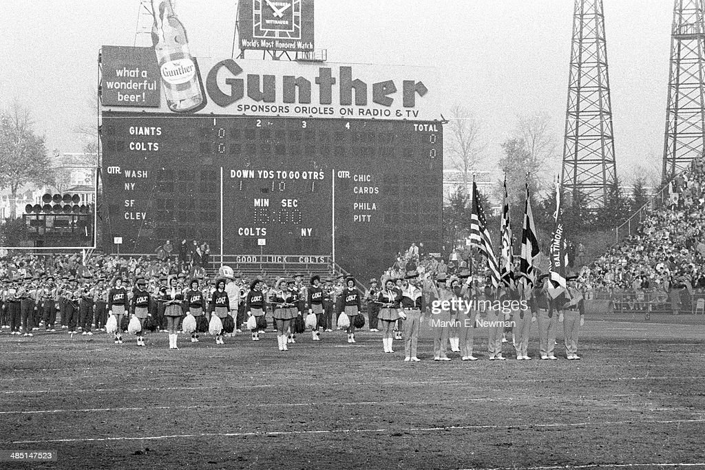 View of Baltimore Colts color guard and cheerleaders before game vs New York Giants at Memorial Stadium. Marvin E. Newman C6F3 )