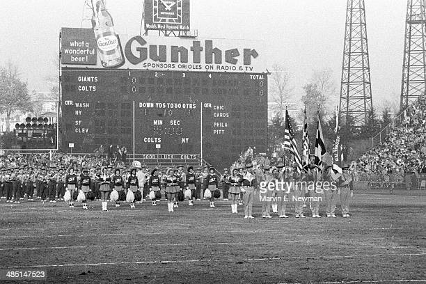 NFL Championship View of Baltimore Colts color guard and cheerleaders before game vs New York Giants at Memorial Stadium Baltimore MD CREDIT Marvin E...