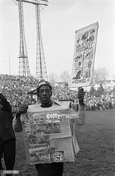 NFL Championship View of fan holding sign and newspaper clippings during Baltimore Colts vs New York Giants game at Memorial Stadium Baltimore MD...