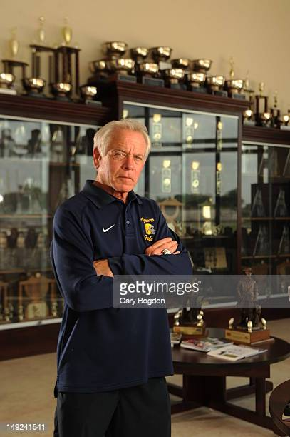 Concussions Special Report: Portrait of St. Thomas Aquinas High athletic director George Smith during photo shoot at school's trophy room. Smith...