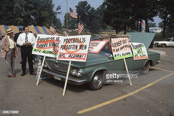 NFL Hall of Fame Game Overall view of picket signs belonging to NFL players and alumni resting on car in parking lot during lockout outside of...
