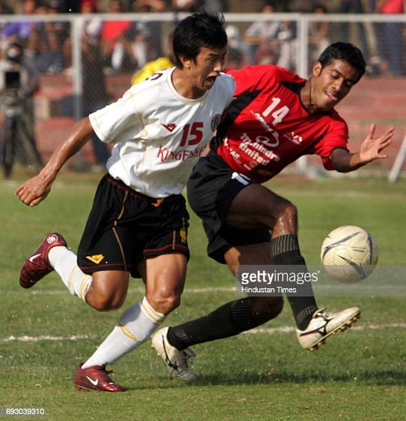 Football NFL Match Bhaichung Bhutia of East Bengal and Mahesh Gawli of Mahindra United struggle to take control over a ball in the NFL at cooperage...
