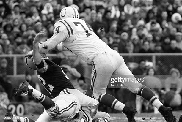 NFL Playoffs Baltimore Colts Billy Ray Smith in action tackle vs Green Bay Packers QB Zeke Bratkowski at Lambeau Field Green Bay WI CREDIT Neil Leifer
